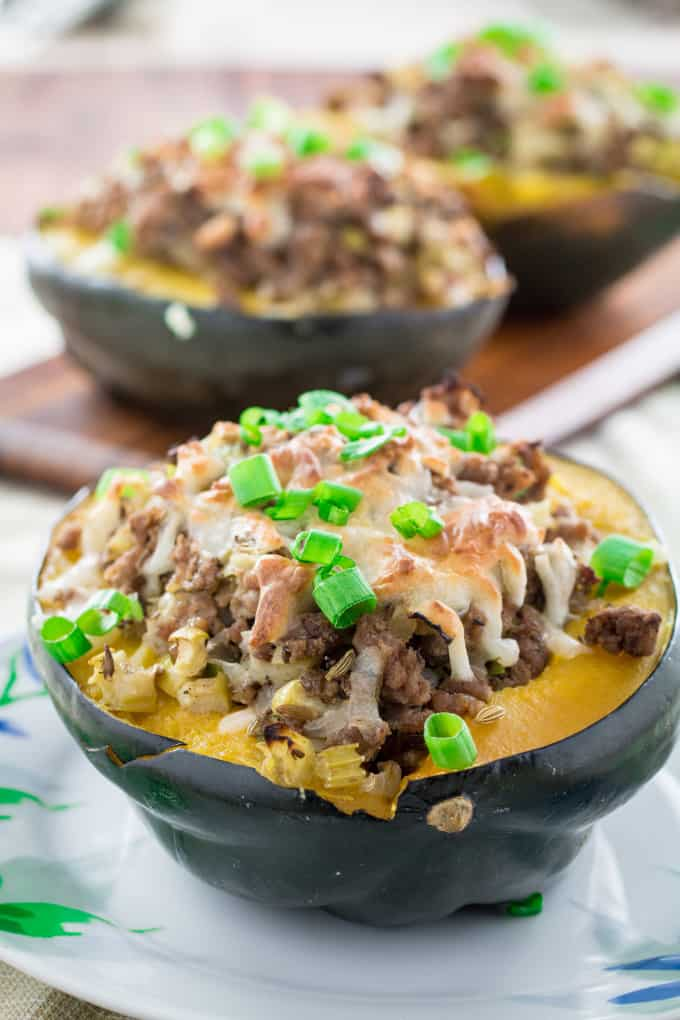 Sweet, nutty acorn squash stuffed with a savory homemade turkey sausage, onions and gooey mozzarella cheese and baked to perfection. You won't believe how simply easy these are to make, and they look so fancy! Serve this satisfying Acorn Squash Stuffed with Turkey Sausage as a side dish during the holidays or as the main course!