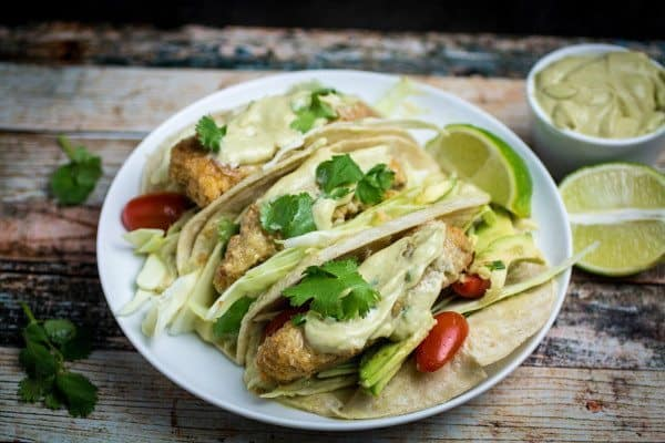 Oven Fried Fish Tacos with Spicy Avocado Cream Sauce