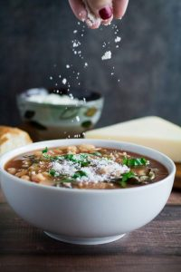 Hearty, savory, and satisfying, this easy Slow Cooker Kale and White Bean Soup is the perfect no-fuss meal on a chilly autumn night. Italian flavors of garlic, basil, and thyme come together in slow cooker perfection, leaving you with a nutritious meal that feeds both your body and your soul. Top with parmesan and enjoy a meal that's so easy to make and ready when you are!