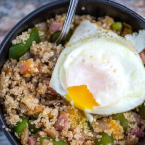 country quinoa bowl closeup with over easy egg on top