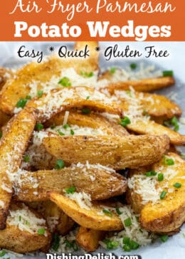 Pinterest pin of side view of air fryer potato wedges topped with parmesan and chopped chives. Graphic says Quick, Easy, and Gluten Free
