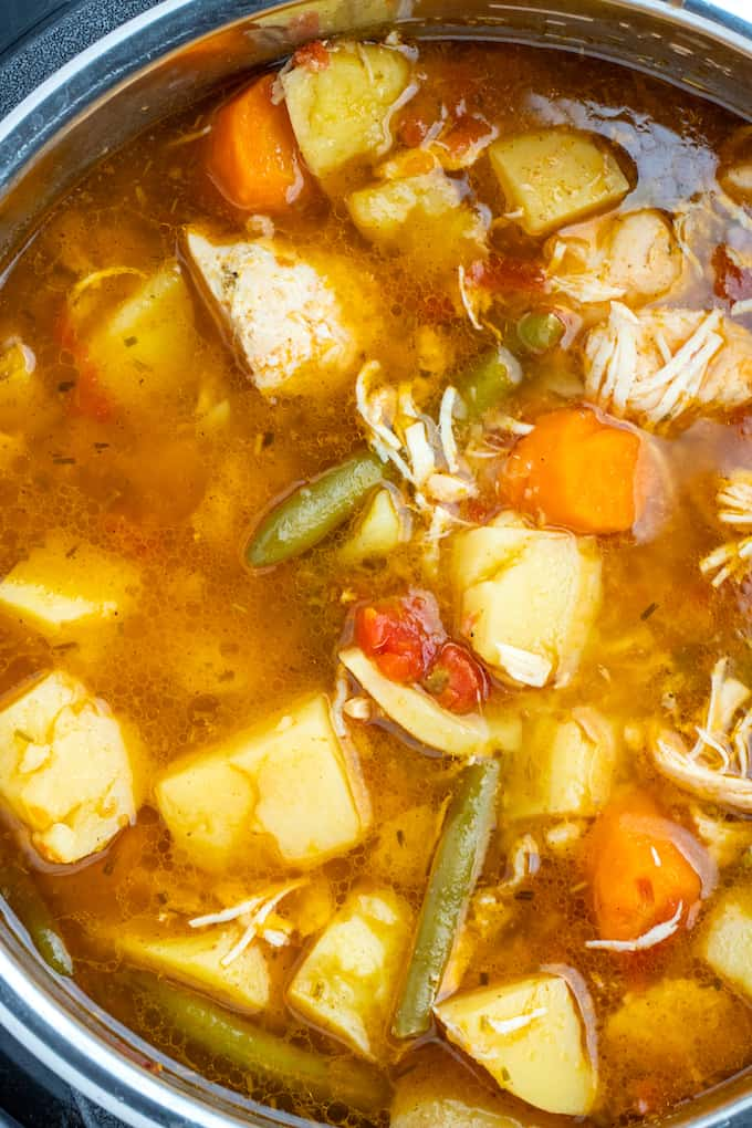 Top down photo of chicken stew inside of the instant pot pot.